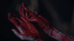 Terrible murder, hands of killer covered with blood and trembling with fear Stock Footage