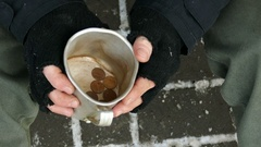 4K.  Some cents in mug  for homeless  unemployment adult man. Top view Stock Footage