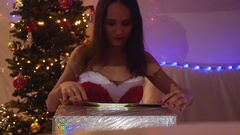 Young happy woman opening the magical Christmas present in slow motion. Girl Stock Footage