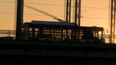 Trolley cross the bridge in sunset time. Saint-Petersburg, Russia Stock Footage