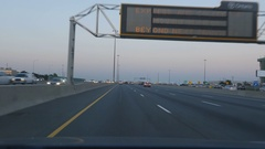 Driving east on the 401 in Toronto near Yorkdale. Overhead sign. Stock Footage