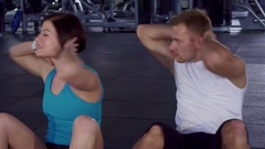 Fitness man and woman train their abdominal muscles Stock Footage