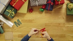 "Top View Time-Lapse of a Man Cutting Letters for Words ""Merry Christmas""  Stock Footage"