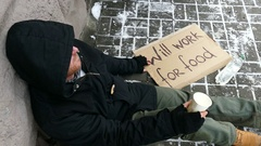 4K.  City winter  street and homeless  unemployment adult man consider cents.  Stock Footage