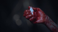 Possessed person holding a piece of glass in bloody hand, nightmare and horror Stock Footage