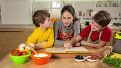 Three kids reading the cook book, making the dinner Stock Footage
