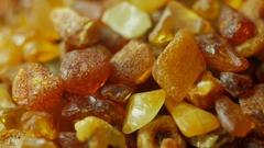 Amber stones on turn table Stock Footage