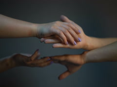 Two pairs of female hands touching each other. Stock Footage