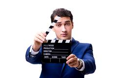 Handsome man with movie clapper isolated on white Stock Photos