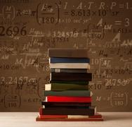 Books on vintage background with math formulas Kuvituskuvat