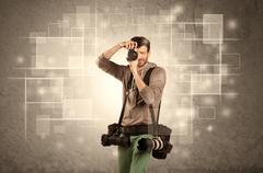 Male holdig professional camera with lens Stock Photos