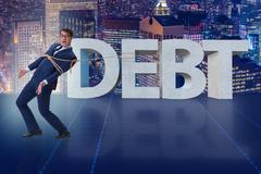 Man in debt business concept Kuvituskuvat