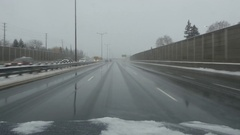 Driving on wet, winter highway. QEW going west. Toronto, Canada. Stock Footage