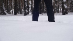 Man dives head first into the Deep Snow and Have Fun in the Winter Forest. Slow Stock Footage