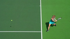 A younf Woman playing Tennis backhand return. Stock Footage