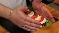 Close up preparing salad with mozzarella Stock Footage