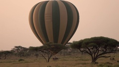 CLOSE UP: Tourists getting ready to lift off on amazing balloon safari adventure Stock Footage