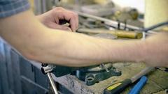 Man sawing metal Stock Footage