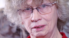 The elder woman closeup. Gray hair and glasses Stock Footage