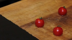 Small tomato at kitchen table Stock Footage