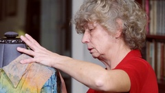Senior woman making a dress on a mannequin. In the room, even light. Woman Stock Footage