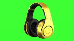 Golden headphones loop rotate on green chromakey background Stock Footage
