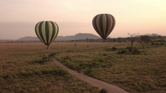 CLOSE UP: Ballooning over savannah endless plains rolling into the distance Stock Footage