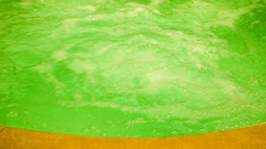 Stream of water from a green big basin Stock Footage