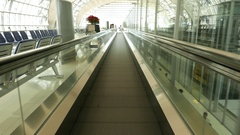 Sliding airport travelator. Subjective view, slow motion. Stock Footage