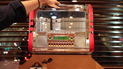 Man Using Old Jukebox in American Diner Stock Footage