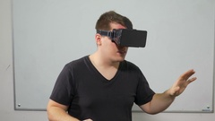 Guy experiencing video game in virtual reality with special equipment headset Stock Footage
