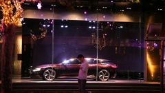 Showroom window with car sale and electronic billboard screen in Beijing, China Stock Footage