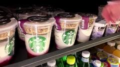 Woman picking fruit yogurt inside Starbucks store with 4k resolution. Stock Footage