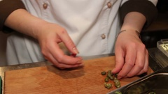 Chef cooking caper sauce Stock Footage