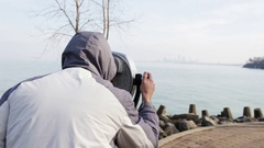 Man looks through generic tower viewer at Cleveland Stock Footage