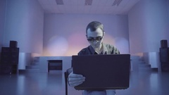 Man uses laptop being alone on the nightclub Stock Footage