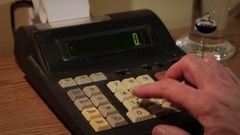 Hand operates old retro calculator at workstation Stock Footage