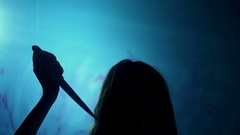 Female demon making multiple stabs with bloody knife, evil spirit, crime scene Stock Footage
