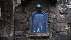 The icon on the wall of a Gothic cathedral in Barcelona. Spain. 4K. Stock Footage