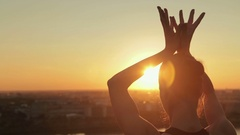 Sporty woman practicing yoga in the park at sunset - lotus mudra Stock Footage