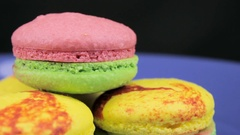 A Colorful Macaroons revolve a clockwise on a dark background Stock Footage