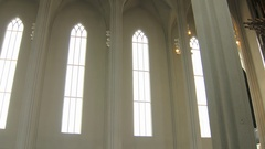 Camera moves from narrow windows to huge organ, inside christian church Arkistovideo