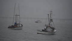 Fishing Boats Off Central California During A Rain Storm Stock Footage