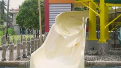Woman rides on waterpark slide Stock Footage