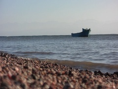 Low angle sand waves with boat Stock Footage