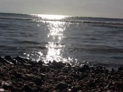 Low angle sunrise water Stock Footage
