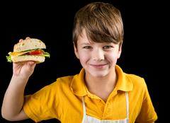 Boy with sandwich in hand Stock Photos