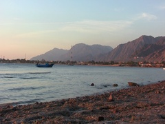Bright waves boat mount sinai egypt Stock Footage
