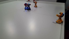 Humanoid robots controlled by a smartphone fighting on the robotics exhibition Stock Footage