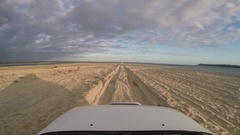 4x4 vehicle driving on Rainbow beach for Fraser Island Stock Footage